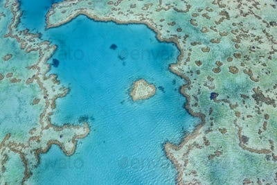 Aerial view of turquoise reef in the Pacific Ocean.