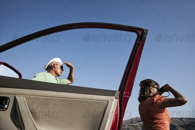 An Hispanic senior couple enjoying the scenery from a rest stop, Grande Ronde USA.