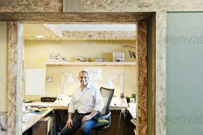 Portrait of a male Hispanic American architect in his office.