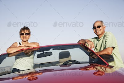 A hip senior Hispanic couple on a road trip in eastern Washington State, USA.