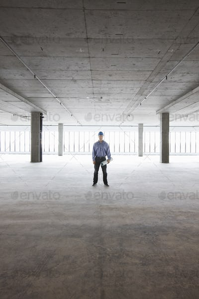 A Caucasian male architect in a new raw business space.