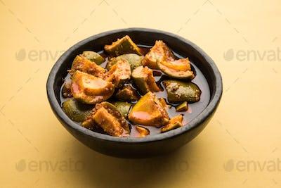 Indian Homemade Raw Mango Pickle or aam ka achar or Kairi Loncha in a bowl