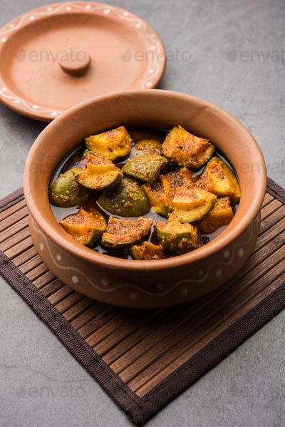 Indian Homemade Raw Mango Pickle or aam ka achar or Kairi Loncha in a bowl