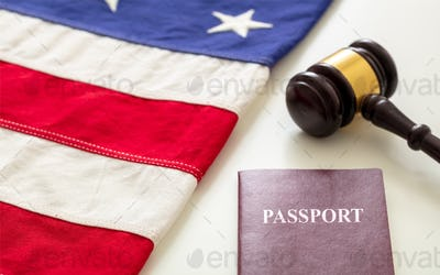 Passport, law gavel and USA flag on white background, close up view.