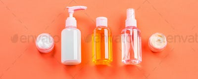 Generic beauty products on orange coral
