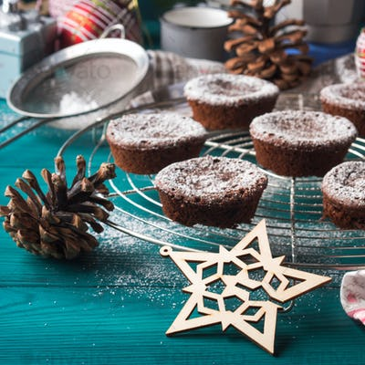 Chocolate winter muffins with icing sugar