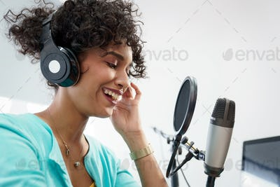 Attractive African American Young Woman Doing Online Podcast With Microphone
