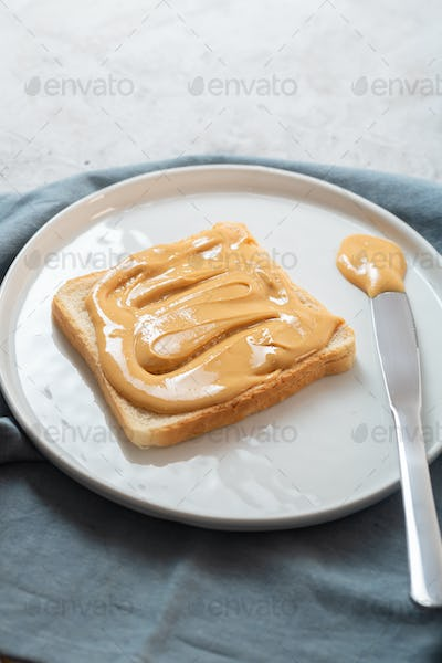 Nut butter with bread on the table