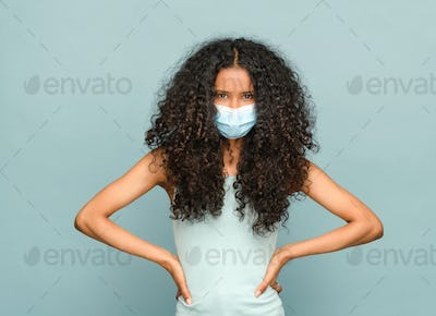 Young black Dominican woman wearing a mask