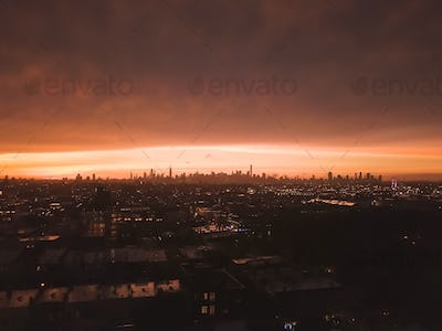 Aerial View from Brooklyn over far away Manhattan Skyline after Sunset