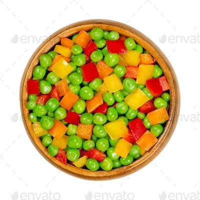 Green peas and diced bell peppers, mixed vegetables in wooden bowl