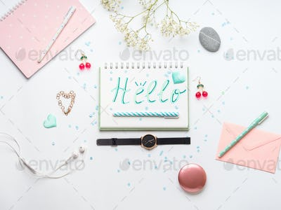 Spring girl accessories items flat lay. Hello word