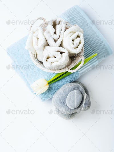 Fresh Towels and stones on white background