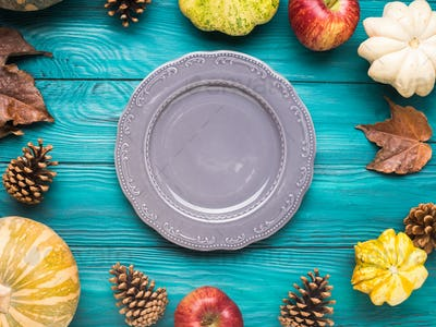 Empty plate on Green autumn background