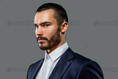 Portrait of bearded male in a suit.