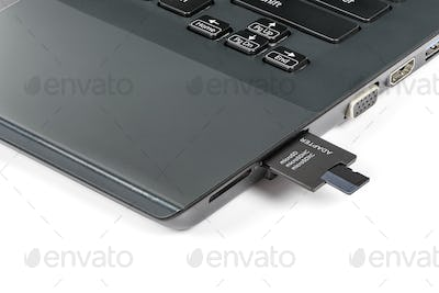 Memory card inserting into adapter and laptops card reader