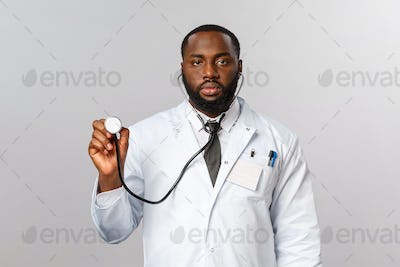 Covid19, hospital check-up and healthcare concept. Serious-looking african-american male doctor in