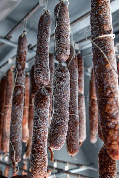 Dried-up salami hanged up