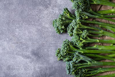 Border with Broccolini on Grey Stone Background.