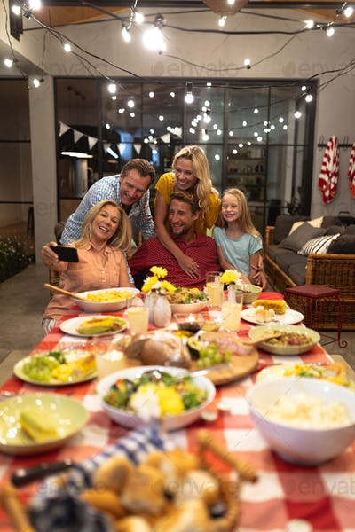 Multi-generation Caucasian family during a dinner and taking a selfie