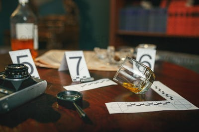 Crime scene, evidence with numbers on the table