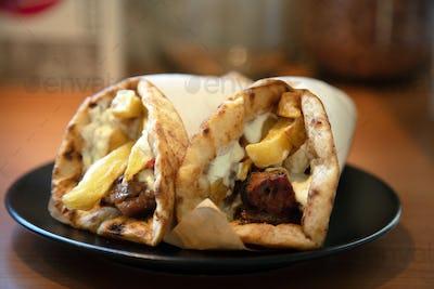 Gyro pita, shawarma, take away, street food. Traditional greek turkish meat food