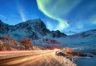 Northern light and road on the Lofoten islands, Norway. Long exposure photography