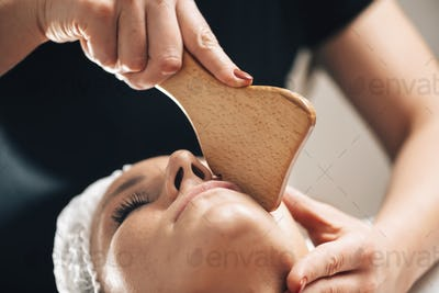Face Massage with Wooden Gua Sha Plate Shape Massager