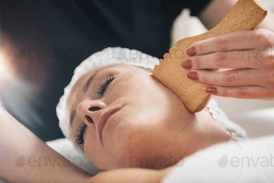 Face Massage with Wooden Gua Sha Plate Shape Massager