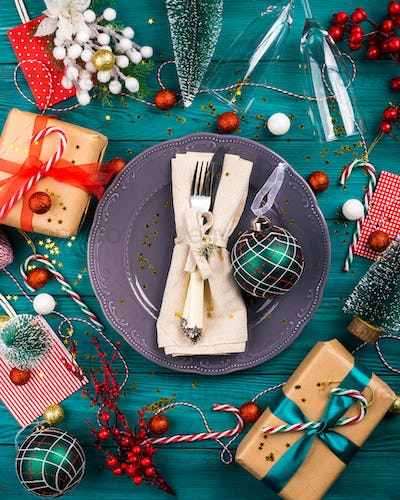 Christmas dark green background with tableware