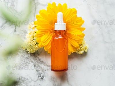 Vitamic C anti aging serum in orange bottle