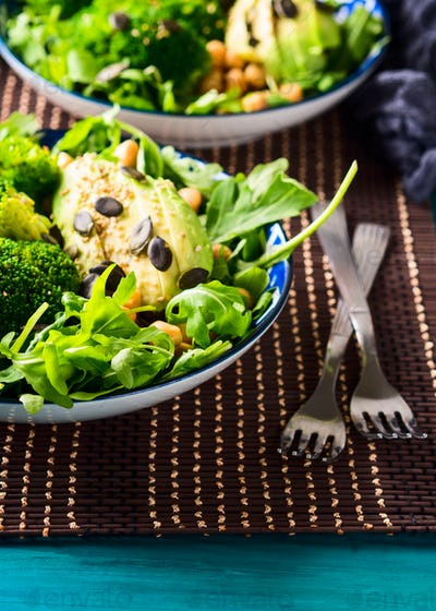 Plant based lunch meal with broccoli and avocado.