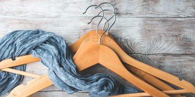 Wooden clothes hangers. What to wear. Banner