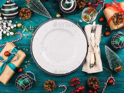 Christmas dark green background with empty dish