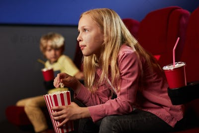 Blonde Teenage Girl in Cinema