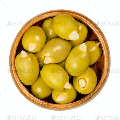 Almond stuffed green olives in a wooden bowl