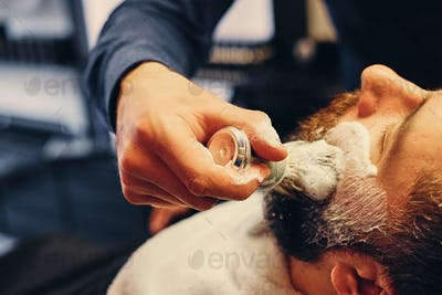 Close up image of barber shaving