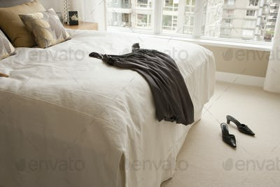45125,Dress Lying on Bed