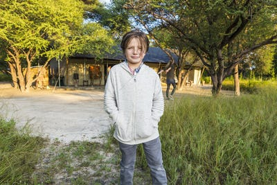 portrait of 6 year old boy, tented camp,Maun,Botswana
