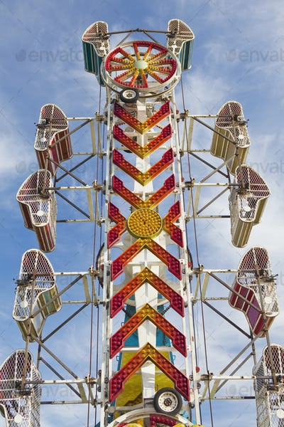 52837,Empty Amusement Park Ride, a tower with empty cars motionless