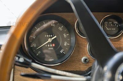 54372,Close up of speedometer in retro Ferrari dashboard