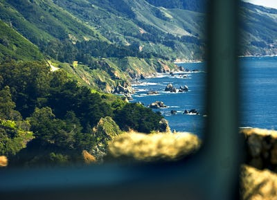 View along the steep cliffs and rocky shore, highway 1 in California.