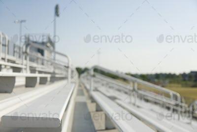 51933,Bleachers, staggered stadium seats at a sports field.