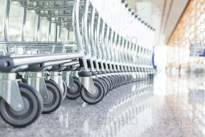 54523,Close up of wheels of stacked airport carts