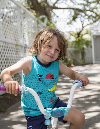 smiling 5 year old boy on his bike, Georgia
