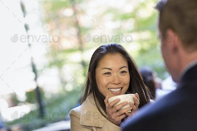 A man and woman sitting in a coffee shop.