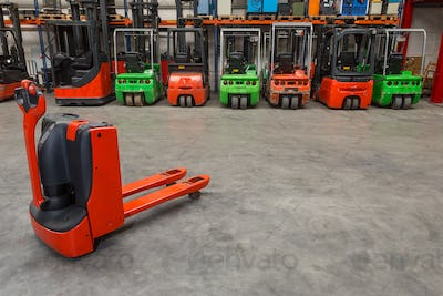 55131,Mechanical dolly and forklift machinery in warehouse