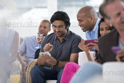 A group of people gathering together for a party or an office event.