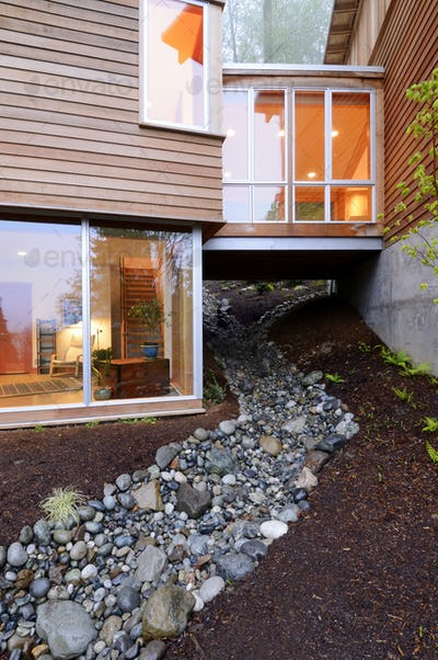 54216,Corridor of modern house built over rocky creek
