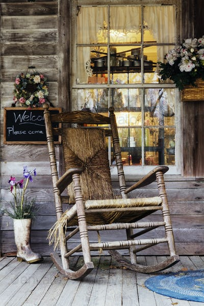 51390,Old Wooden Rocking Chair on a Wooden Porch